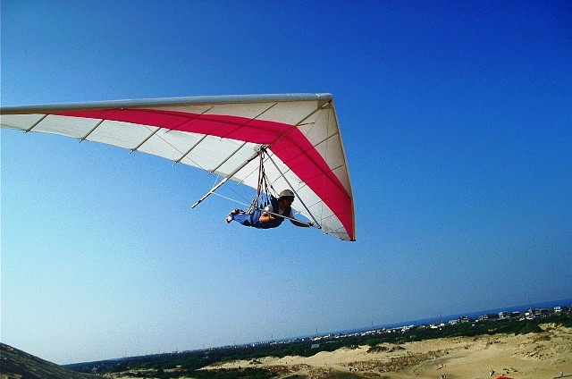 Hang Glider at Jockeys Ridge State Park-BillRuss-VisitNC.com