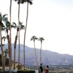 PALM SPRINGS-Couple enjoying cocktails by pool with panaromic view